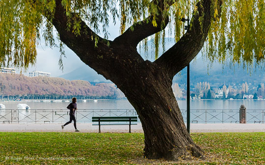Jogger in lakeside park in Annecy