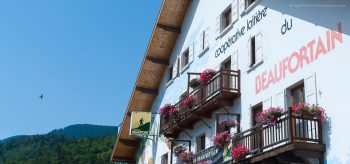 Low view of chalet-style facade of laiterie cooperative, Beaufort in summer.