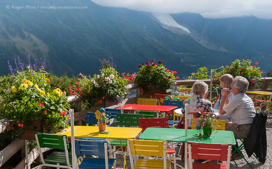 View of family on the terrace f the Chalet de La Floria above Chamonix