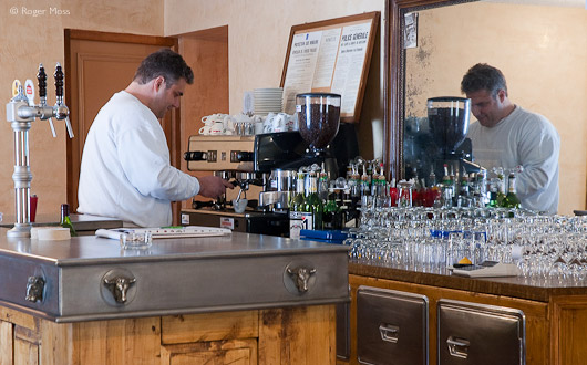 Franck Patelli prepares un café noir at the beautifully-restored Café Pension de Savoie in Abondance.