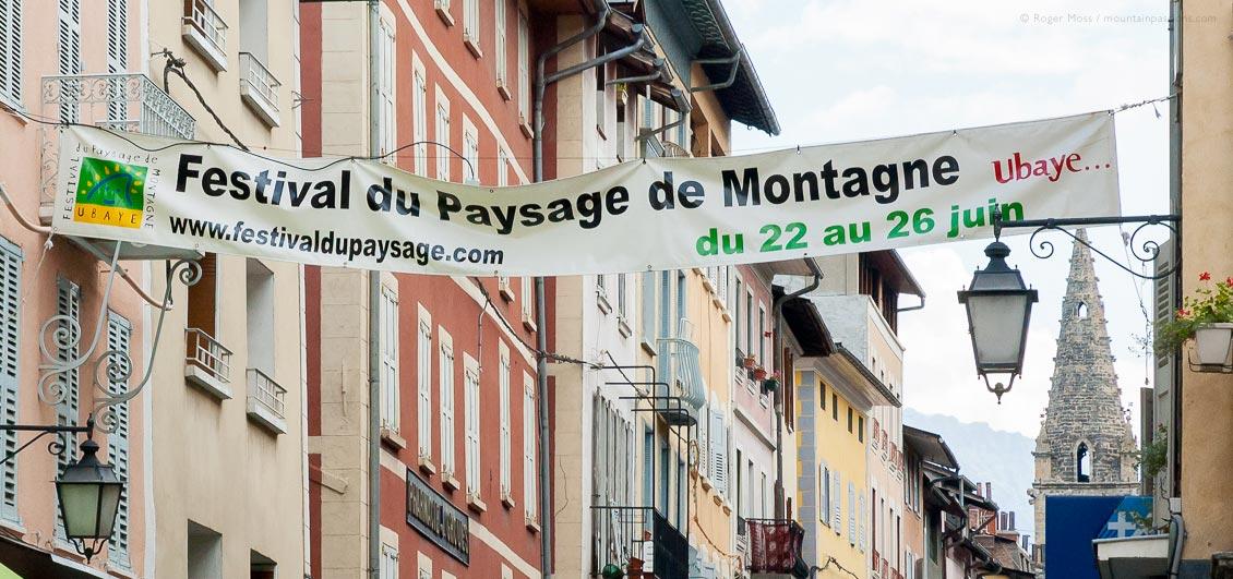 View of mountain festival banner across street in Barcelonnette