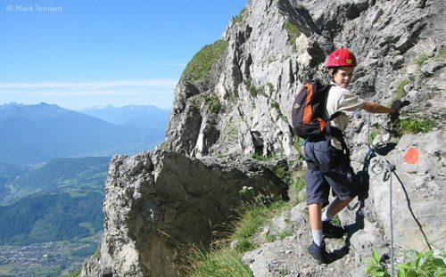 boy on via ferrata route, French Alps