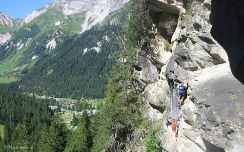 high view of via ferrata and landscape below, French Alps