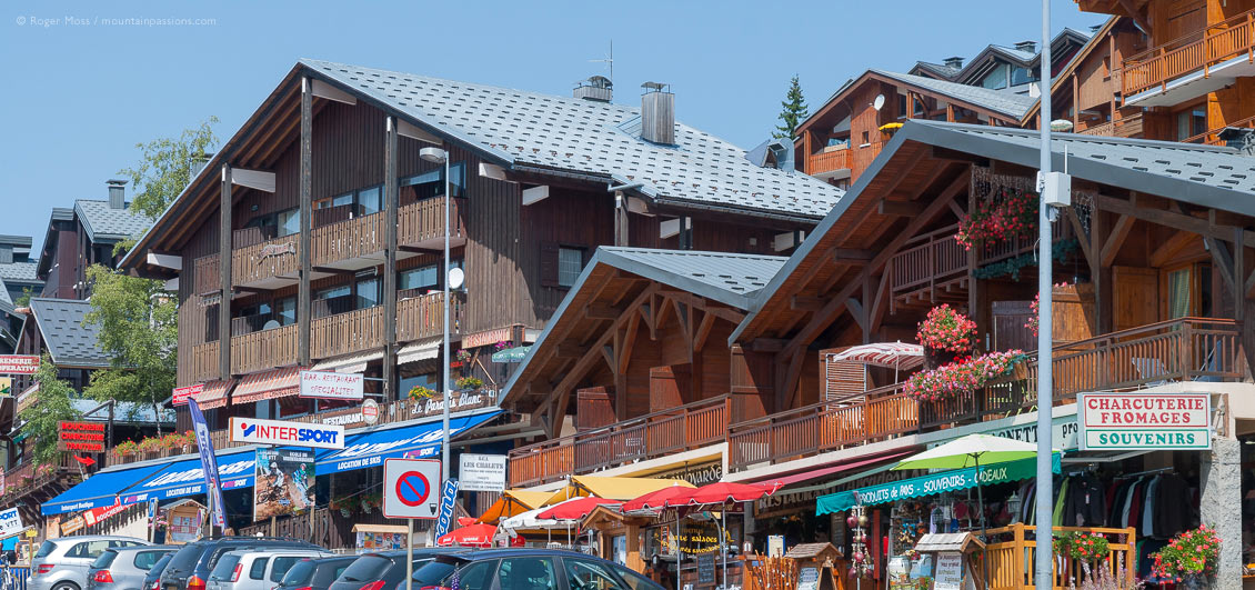 Low view of chalet-style boutiques and apartments in village centre of Les Saisies