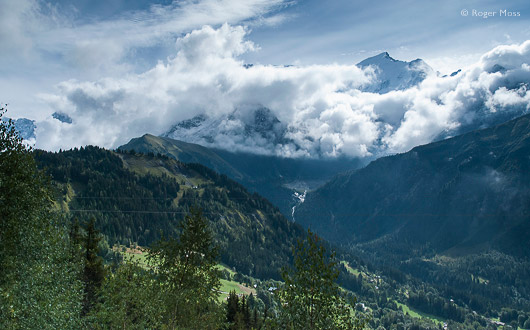 The snow-capped summit of Mont-Blanc appears above the cloud seen from the Mont Blanc Tramway.
