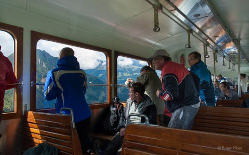 Passengers on the Mont Blanc tram looking at the spectacular mountain scenery.