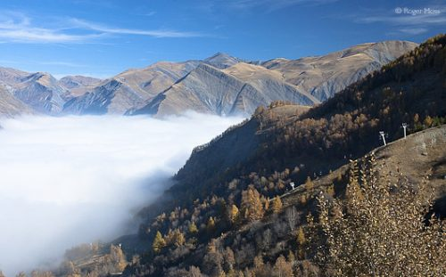 Morning sun disperses overnight mists in the valleys below Les Deux-Alpes.
