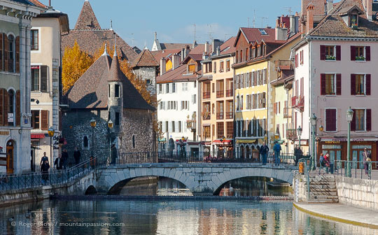 View of stone bridge with Annecy old town in background