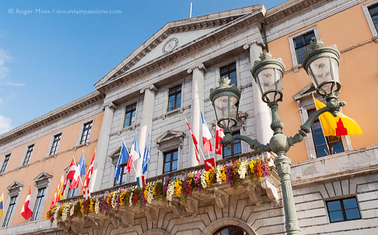 Low view of Annecy Hotel de Ville facade with flags