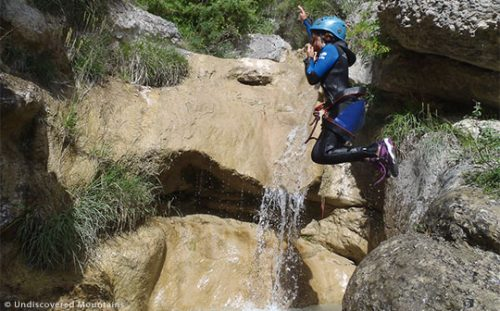 Canyoning suits all ages as long as you can swim. Here a child abseils while canyoning in the southern French Alps.