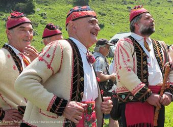 Singers in traditional costume during transhumance festival, French Pyrenees.