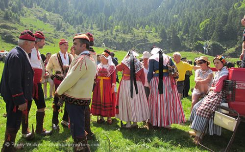 Transhumance Festival with traditional costumes in mountain setting