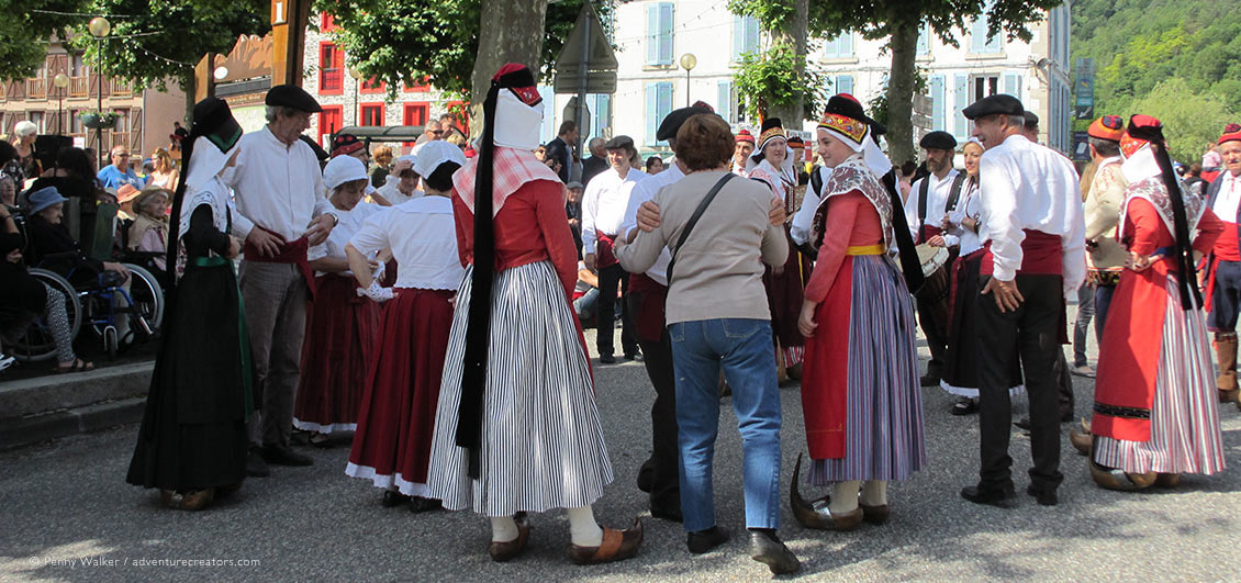 Villagers in traditional costume meeting visitors at Transhumance Festival