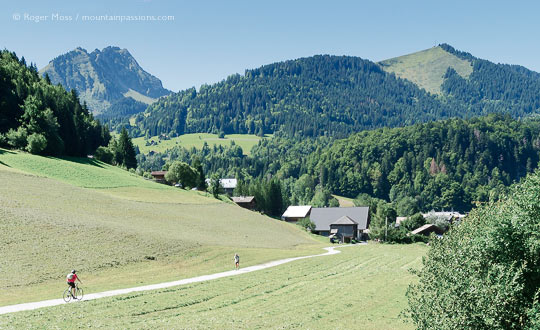 Summer view of cyclist and walker on track near Abondance, French Alps