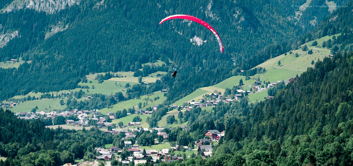 Wide view of parapente flight over Chatel village, French Alps.