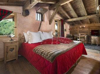 Hotel La Bouitte luxury bedroom in Alpine chalet, St Martin de Belleville, French Alps